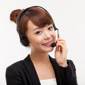 Smiling call center operator business woman — Stock Photo