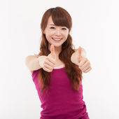 Young pretty Asian woman showing thumb. — Fotografia Stock