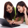 Young Asian woman using laptop — Stock Photo #17626181