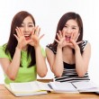 Two young Asian woman studying on the desk — Stock Photo