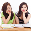 Two Asian young woman having trouble on the desk. — Stock Photo #17626475