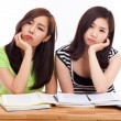 Two Asian young woman having trouble on the desk. — Stock Photo #17626519