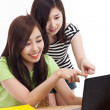 Two Asian young woman using computer on the desk — Stock Photo