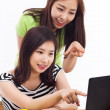 Two Asian young woman using computer on the desk — Stock Photo #17626693