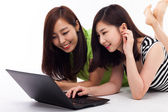 Young Asian woman using laptop — Stok fotoğraf