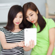Two Asiyoung womusing tablet PC. — Stock Photo #17642655