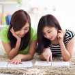 Two happy young beautiful women studying — Stock Photo #17645377
