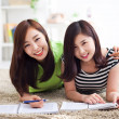 Two happy young beautiful women studying — Stock Photo #17645421