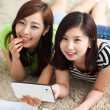 Two Asian young woman using tablet PC and studying. — Stock Photo