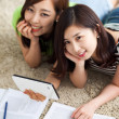 Royalty-Free Stock Photo: Two Asian young woman using tablet PC and studying.