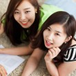 Two Asian young woman using computer and studying. — Stock Photo #17645627