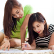 Two happy young beautiful women studying — Stockfoto