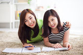Two happy young beautiful women studying — Foto Stock