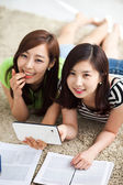 Two Asian young woman using tablet PC and studying. — Foto Stock