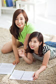 Two happy young beautiful women studying — Stock Photo