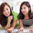 Two happy young beautiful women studying — Stock Photo #17816829