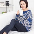 Royalty-Free Stock Photo: Young Asian pretty woman having a cup of coffee.