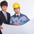 Asian business man and engineer having a blueprint. — Stock Photo #21918367