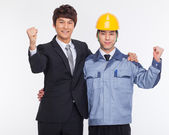 Asian business man and engineer hands up. — Stock Photo