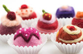 Assortment of colorful felt pralines — Stock Photo
