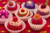 Christmassy assortment of colorful felt pralines — Stock Photo