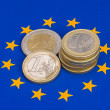 Euro coins on europeflag — Stock Photo #16227501