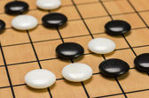 Closeup view of stones on a Go board — Stockfoto