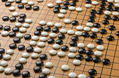 Stones on a Go board — Stock Photo
