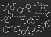 Many chemical formulas on a blackboard — Stock Photo
