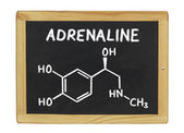 Chemical formula of adrenaline on a blackboard — Stock Photo