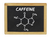 Chemical formula of caffeine on a blackboard — Stock Photo