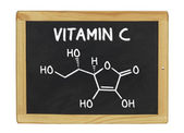 Chemical formula of vitamin c on a blackboard — Stock Photo