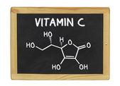 Chemical formula of vitamin c on a blackboard — Stock Photo