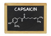Chemical formula of capsaicine on a blackboard — Photo