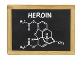 Chemical formula of heroin on a blackboard — Stock Photo