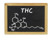 Chemical formula of THC on a blackboard — Stock Photo