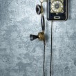 Stock Photo: Antique telephone on a grungy blue wall