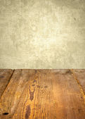 Antique wooden table in front of weathered wall — Stock Photo
