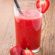 Strawberry smoothie on a wooden table - Stock Photo