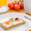 Crispbread with salmon and shrimp on breakfast table — Stock Photo #24548699