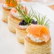 Pastries with salmon, caviar and shrimp — Stock Photo #24550675