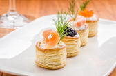Pastries with salmon, caviar and shrimp — Stock Photo