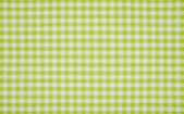 Green and white checkered tablecloth — Stock Photo