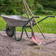 Wheelbarrow with shovel and rake — Stock Photo #26538619
