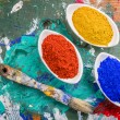 Stock Photo: Vibrant color pigments in porcelain bowls on wooden palette
