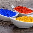Vibrant color pigments  in porcelain bowls — Stock Photo