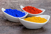 Vibrant color pigments in porcelain bowls — Stock Photo