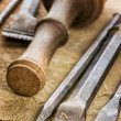 Several chisels with mallet — Stock Photo #27877259