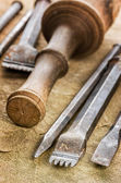 Several chisels with a mallet — Stock Photo