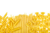 Various types of pasta on a white background — Stock Photo